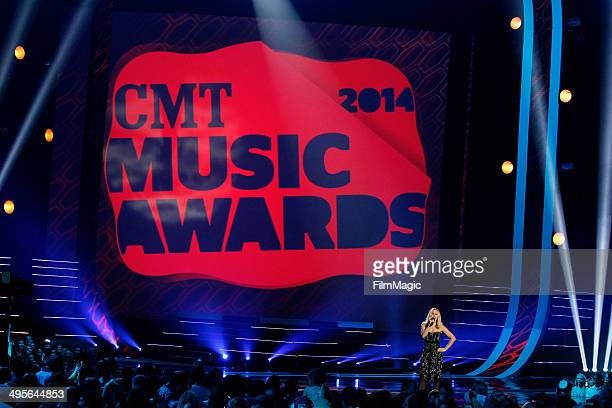 Presenters Jason Aldean and Brooklyn Decker speak during the 2014 CMT Music awards at the Bridgestone Arena on June 4 2014 in Nashville Tennessee