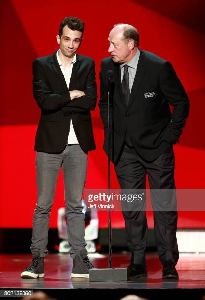 Presenters Jay Baruchel and former NHL player Bob Gainey speak onstage to announce the winner of the Frank J Selke Trophy during the 2017 NHL Awards...