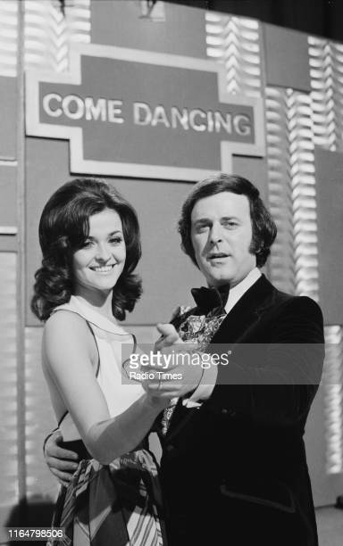 Presenters Jenny McAdam and Terry Wogan on the set of the BBC television series 'Come Dancing', March 29th 1973.