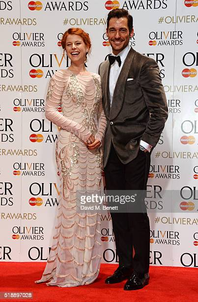 Presenters Jessie Buckley and David Gandy pose in the Winners Room at The Olivier Awards with Mastercard at The Royal Opera House on April 3 2016 in...