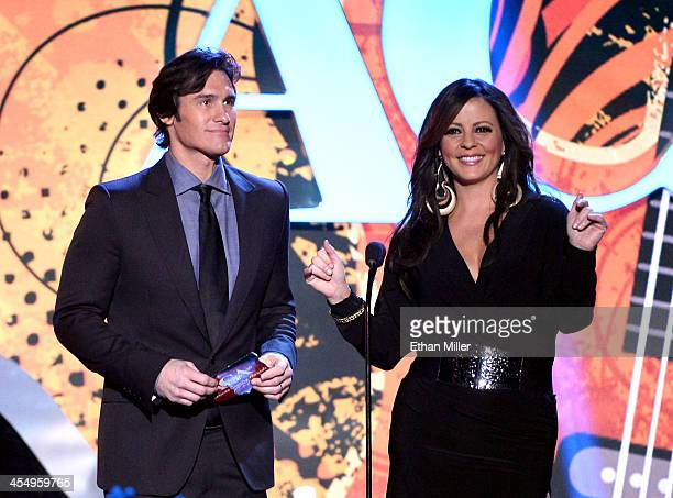 Presenters Joe Nichols and Sara Evans speak onstage during the American Country Awards 2013 at the Mandalay Bay Events Center on December 10 2013 in...