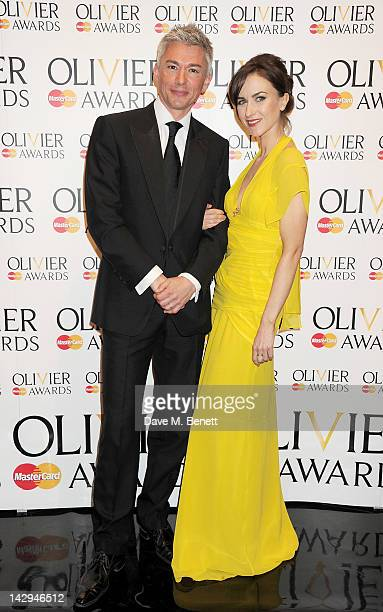 Presenters Jonathan Edwards and Katherine Kelly pose in the press room at the 2012 Olivier Awards held at The Royal Opera House on April 15 2012 in...