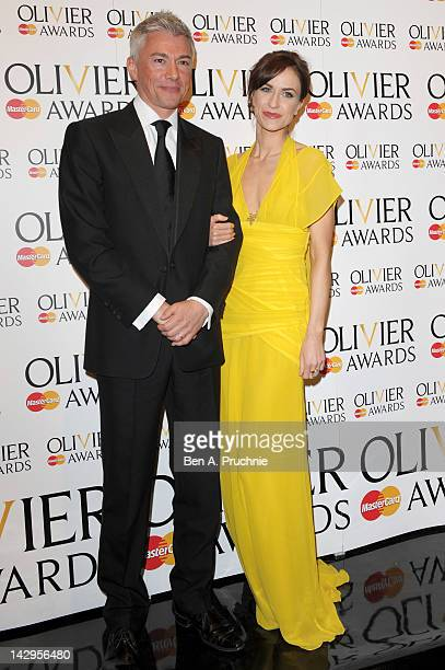 Presenters Jonathan Edwards and Katherine Kelly pose in the press room during the 2012 Olivier Awards at The Royal Opera House on April 15 2012 in...