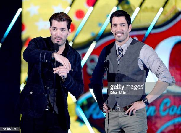 Presenters Jonathan Scott and Drew Scott speak onstage during the American Country Awards 2013 at the Mandalay Bay Events Center on December 10, 2013...