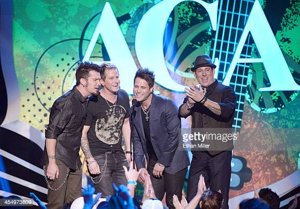 Presenters Josh McSwain, Barry Know, Scott Thomas and Matt Thomas of Parmalee speak onstage during the American Country Awards 2013 at the Mandalay...