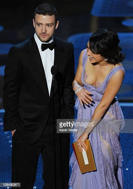 Presenters Justin Timberlake and Mila Kunis speak onstage during the 83rd Annual Academy Awards held at the Kodak Theatre on February 27 2011 in...