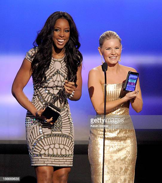 Presenters Kelly Rowland and Elisha Cuthbert speak onstage during the 40th American Music Awards held at Nokia Theatre LA Live on November 18 2012 in...