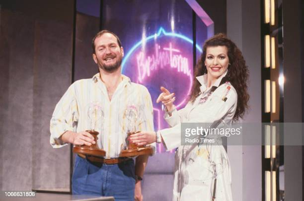 Presenters Kenny Everett and Cleo Rocos pictured on the set of the BBC television show 'Brainstorm' December 23rd 1987