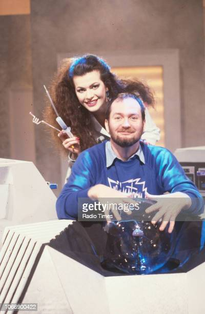 Presenters Kenny Everett and Cleo Rocos pictured with a plasma ball on the set of the BBC television show 'Brainstorm' January 6th 1988