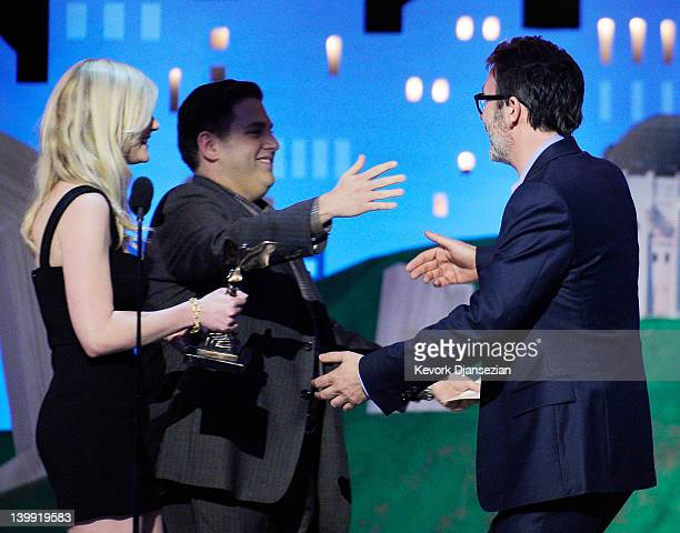 Presenters Kirsten Dunst and Jonah Hill present the award for Best Director for 'The Artist' to director Michel Hazanavicius onstage at the 2012 Film...