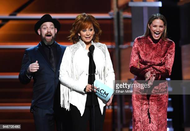 Presenters Kristian Bush and Jennifer Nettles of Sugarland react as host Reba McEntire announces that Album of the Year winner Chris Stapleton's wife...