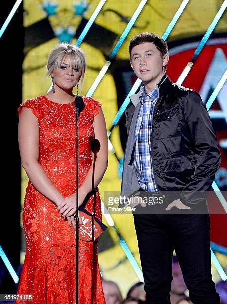 Presenters Lauren Alaina and Scotty McCreery speak onstage during the American Country Awards 2013 at the Mandalay Bay Events Center on December 10...