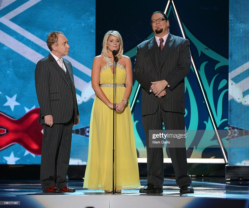 Presenters Lauren Alaina (C) with Teller (L) and Penn Jillette (R) of the comedy magic team Penn & Teller speak onstage during the 2012 American Country Awards at the Mandalay Bay Events Center on December 10, 2012 in Las Vegas, Nevada.