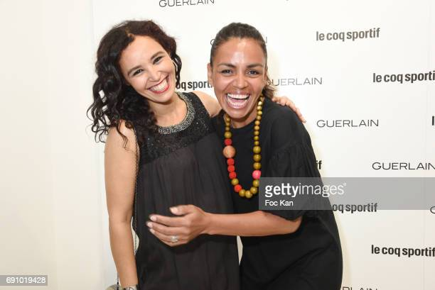 TV presenters Laurence Roustandjee and Aida Touihri attend Le Coq Sportif x Guerlain photocall at the Le Coq Sportif Flagship on May 31 2017 in Paris...
