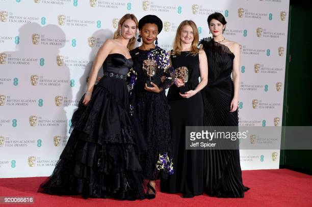 Presenters Lily James and Gemma Arterton and Rungano Nyoni and Emily Morgan winners of the Outstanding Debut by a British Writer Director or Producer...