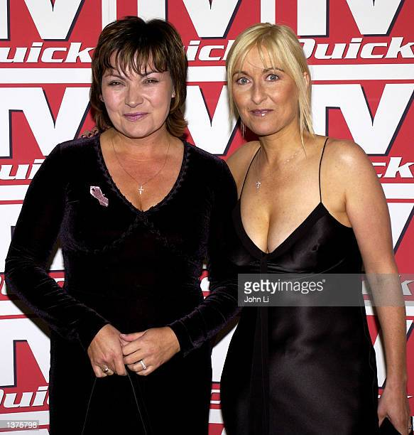 Presenters Lorraine Kelly and Fiona Phillips attend the TV Quick Awards held at The Dorchester Park Lane September 9 2002 in London United Kingdom...