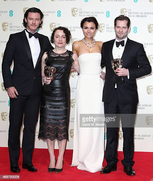 Presenters Luke Evans and Samantha Barks pose with winners of the British Short Film Award for 'Room 8' Sophie Venner and James W Griffiths pose in...