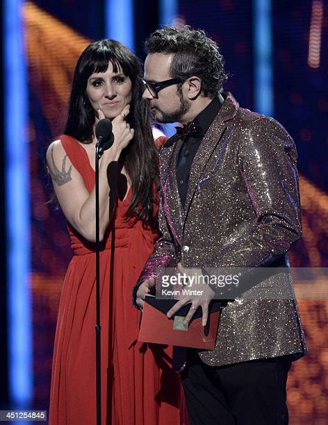 Presenters Mala Rodriguez and Aleks Syntek speak onstage during The 14th Annual Latin GRAMMY Awards at the Mandalay Bay Events Center on November 21...