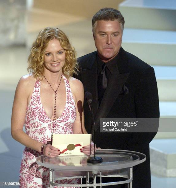 Presenters Marg Helgenberger and William Petersen at the 54th Annual Emmy Awards
