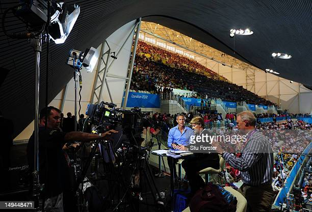 BBC presenters Mark Foster and Clare Balding pictured in the BBC studio on Day 1 of the London 2012 Olympic Games at the Aquatics Centre on July 28...