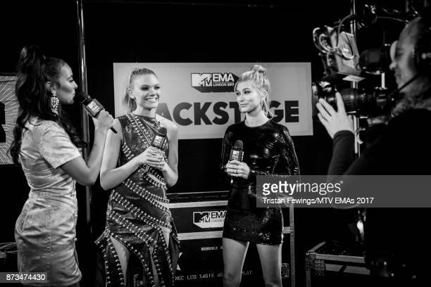 MTV Presenters Maya James and Becca Dudley interview Hailey Baldwin backstage during the MTV EMAs 2017 held at The SSE Arena Wembley on November 12...