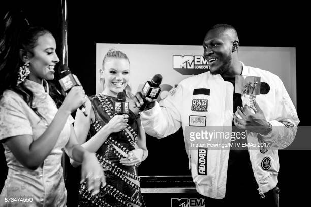 MTV Presenters Maya James and Becca Dudley interview Stormzy backstage during the MTV EMAs 2017 held at The SSE Arena Wembley on November 12 2017 in...
