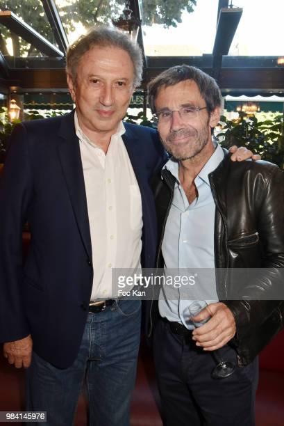 TV presenters Michel Drucker and David Pujadas attend 'L'Ete Litteraire Des Deux Magots ' Book Signing Cocktail at Les Deux Magots Cafe on June 25...