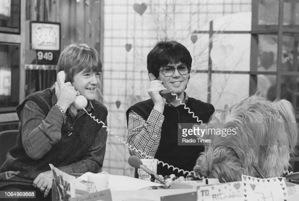 Presenters Mike Read and Keith Chegwin taking part in a phonein on the television show 'Saturday Superstore' circa 1985
