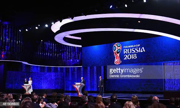Presenters Natalia Vodianova Dmitry Shepelev look on as FIFA President Joseph S Blatter and Vladimir Putin President of Russia during the Preliminary...