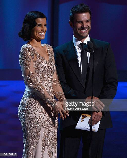 Presenters Nelly Furtado and Mark Tacher speak onstage during the 13th annual Latin GRAMMY Awards held at the Mandalay Bay Events Center on November...