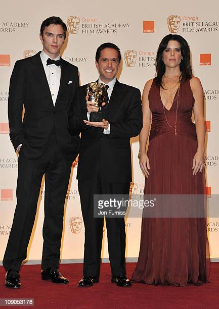 Presenters Nicholas Hoult and Neve Campbell pose with Lee Unkrich winner of the award for Animated Film for the film Toy Story 3 during the 2011...