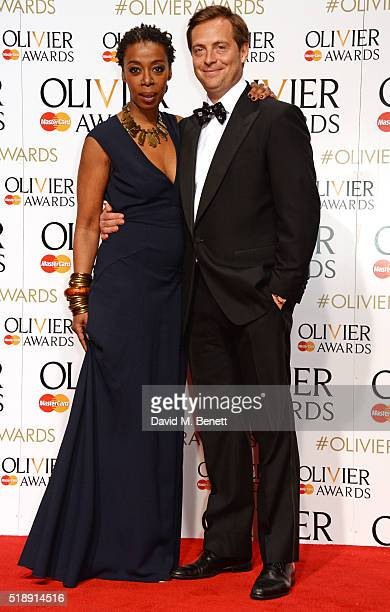 Presenters Noma Dumezweni and Stephen Campbell Moore pose in the Winners Room at The Olivier Awards with Mastercard at The Royal Opera House on April...