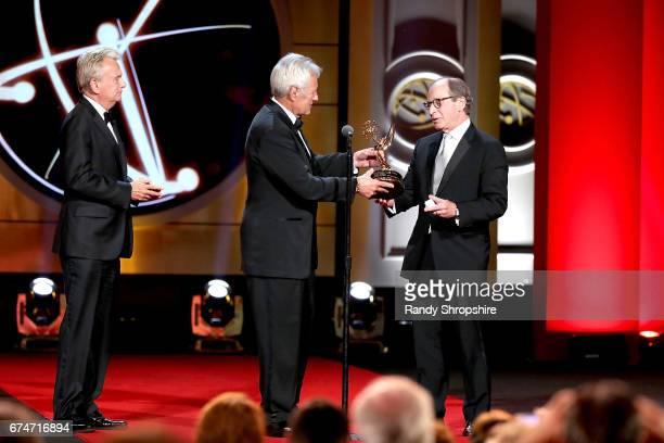 Presenters Pat Sajak, Alex Trebeck and lifetime achievement award winner Harry Friedman attend the 44th annual daytime creative arts Emmy awards show...