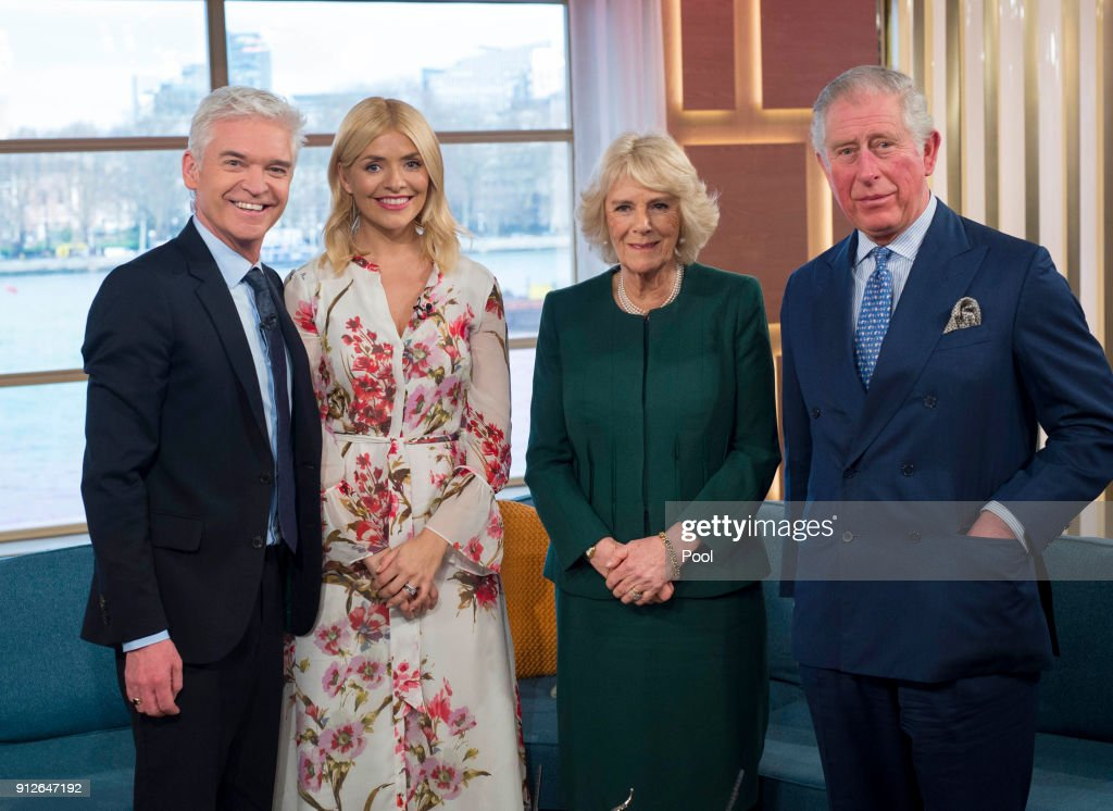 Presenters Philip Schofield and Holly Willoughby pose for a photo with Camilla, Duchess of Cornwall and Prince Charles, Prince of Wales after filming for ITV's 'This Morning' during their visit to celebrate the 90th anniversary of the Royal Television Society at London Television Centre on January 31, 2018 in London, United Kingdom.