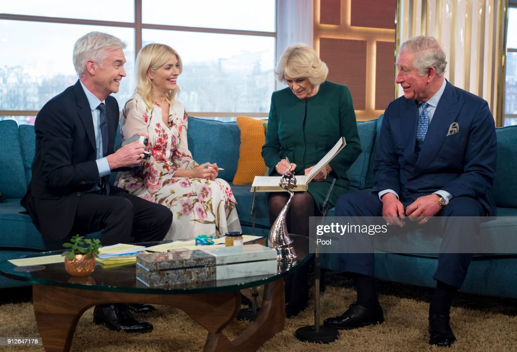 Presenters Philip Schofield and Holly Willoughby share a joke on the sofa with Camilla, Duchess of Cornwall and Prince Charles, Prince of Wales after filming for ITV's 'This Morning' during their visit to celebrate the 90th anniversary of the Royal Television Society at London Television Centre on January 31, 2018 in London, United Kingdom.