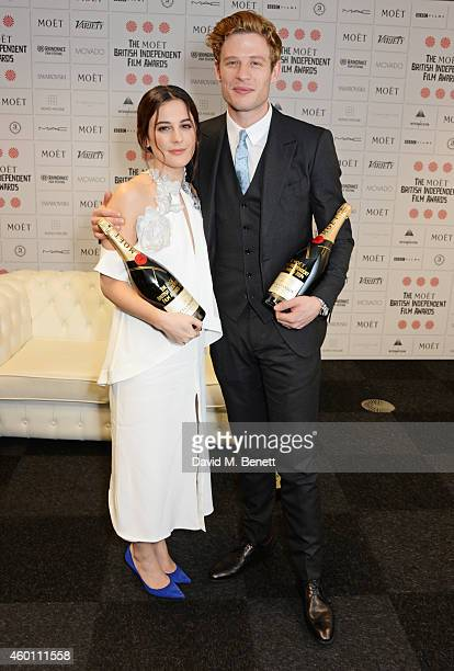 Presenters Phoebe Fox and James Norton pose at The Moet British Independent Film Awards 2014 at Old Billingsgate Market on December 7 2014 in London...