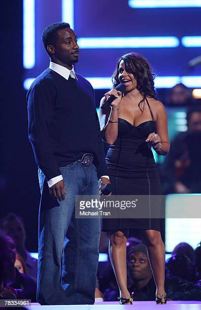 Presenters Raghib 'Rocket' Ismail and Vida Guerra speak during the Spike TV's 2007 'Video Game Awards' at the Mandalay Bay Events Center on December...