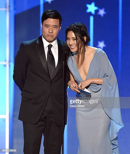 Presenters Randall Park and Constance Wu speak onstage during the 21st Annual Critics' Choice Awards at Barker Hangar on January 17 2016 in Santa...