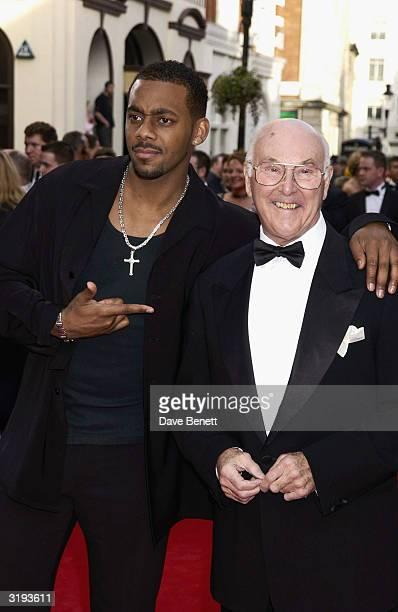 Presenters Richard Blackwood and Murray Walker arrive at the BAFTA'S 2002 in Drury Lane on April 21st, 2002 in London.