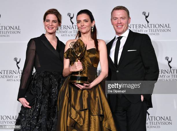 Presenters Rike Schmid Diego Klattenhoff with Marina Gera winner of Best Performance by an Actress during the 2019 International Emmy Awards Gala on...