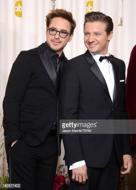 Presenters Robert Downey Jr and Jeremy Renner pose in the press room during the Oscars held at Loews Hollywood Hotel on February 24 2013 in Hollywood...
