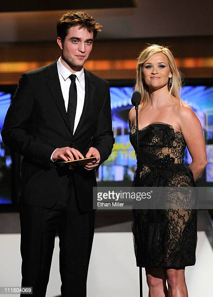 Presenters Robert Pattinson and Reese Witherspoon speak onstage at the 46th Annual Academy Of Country Music Awards held at the MGM Grand Garden Arena...