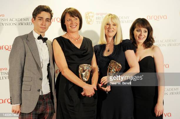 Presenters Robert Sheehan, winners of Best Single Drama Polly Leys and Kate Norrish, and actress Claire Foy pose in front of the winners boards at...