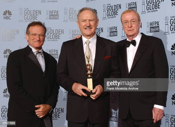 Presenters Robin Williams and Michael Caine with Cecil B DeMille Award winner Gene Hackman backstage at the 60th Annual Golden Globe Awards held at...