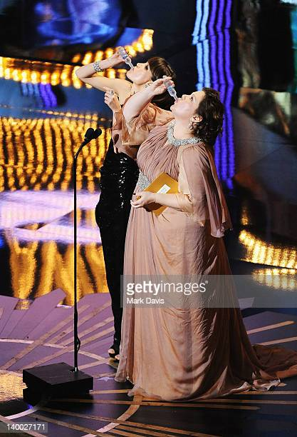 Presenters Rose Byrne and Melissa McCarthy speak onstage during the 84th Annual Academy Awards held at the Hollywood Highland Center on February 26...