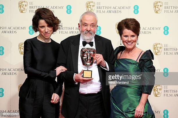 Presenters Sally Hawkins Imelda Swinton and director Mike Leigh winner of the Fellowship award pose in the winners room at the EE British Academy...