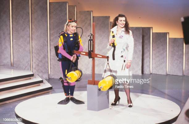 Presenters Sarah Greene and Cleo Rocos demonstrating scuba gear for the BBC television show 'Brainstorm' January 6th 1988