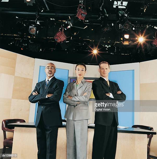 TV Presenters Standing in a TV Studio