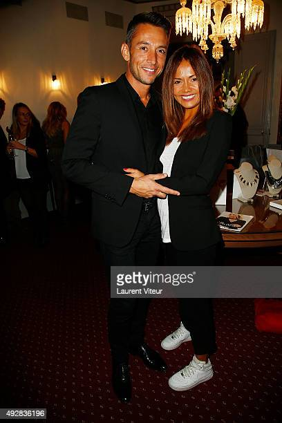 Presenters Stephane Jobert and Karine Arsene attends the Stella Dot Cocktail Party To Benefit Octobre Rose on October 15 2015 in Paris France