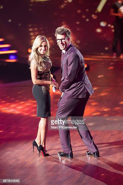 Presenters Sylvie Meis and Daniel Hartwich perform onstage during the first show of the television competition 'Stepping Out' on September 11 2015 in...
